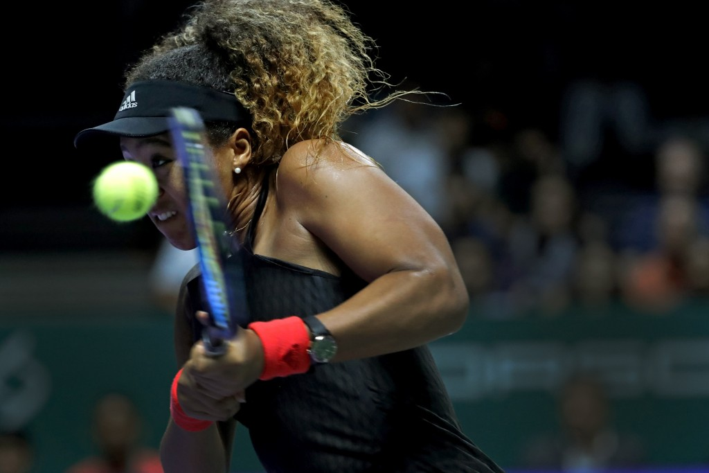 Naomi Osaka of Japan returns a shot to Sloane Stephens of the United States during their women's singles match at the WTA tennis tournament in Singapo