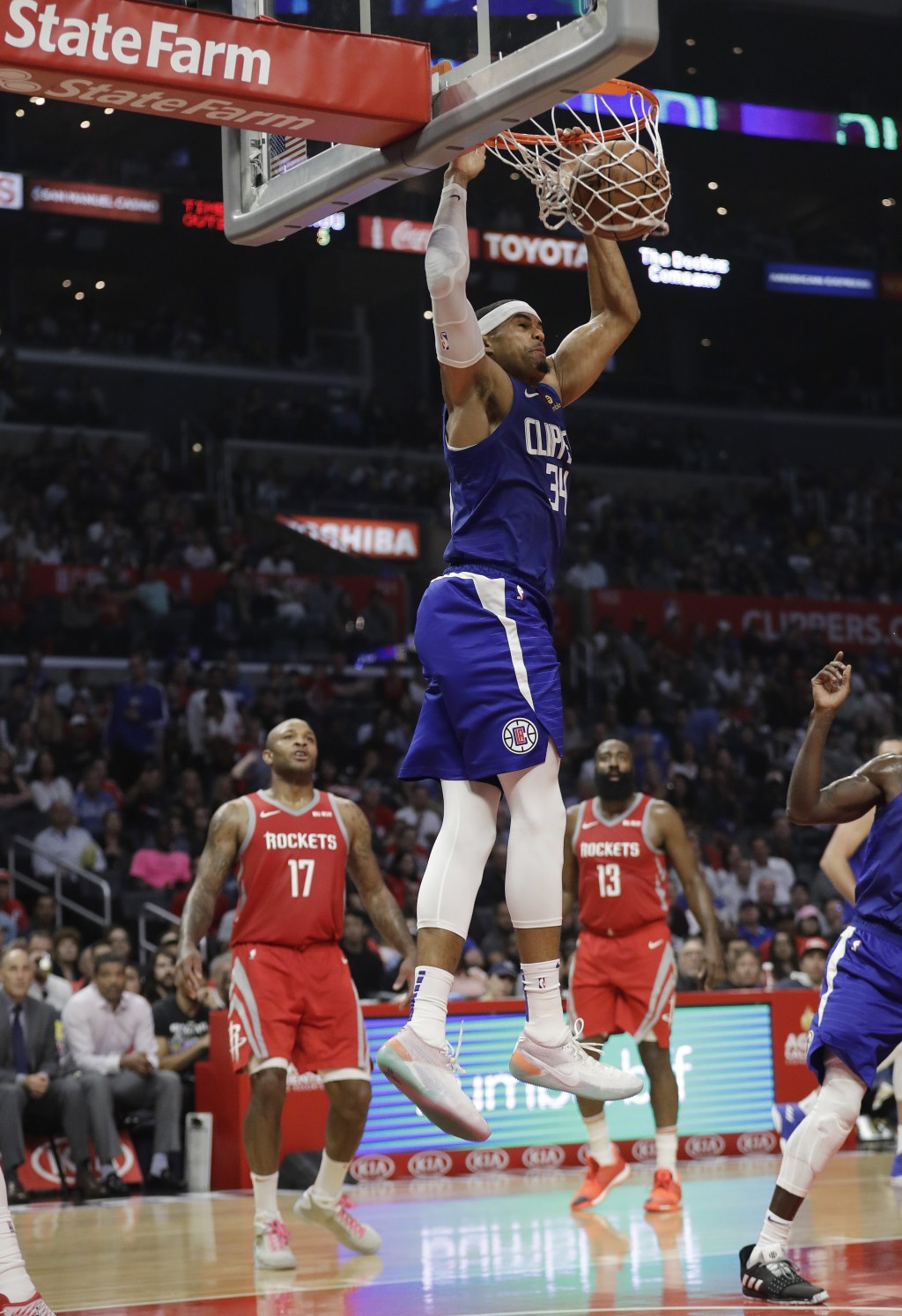 Los Angeles Clippers' Tobias Harris (34) dunks against the Houston Rockets during the first half of an NBA basketball game Sunday, Oct. 21, 2018, in L...