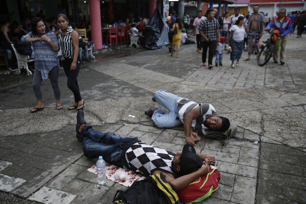 Central American migrants making their way to the U.S. in a large caravan rest lying at the central park in Tapachula, Mexico, Sunday, Oct. 21, 2018. ...