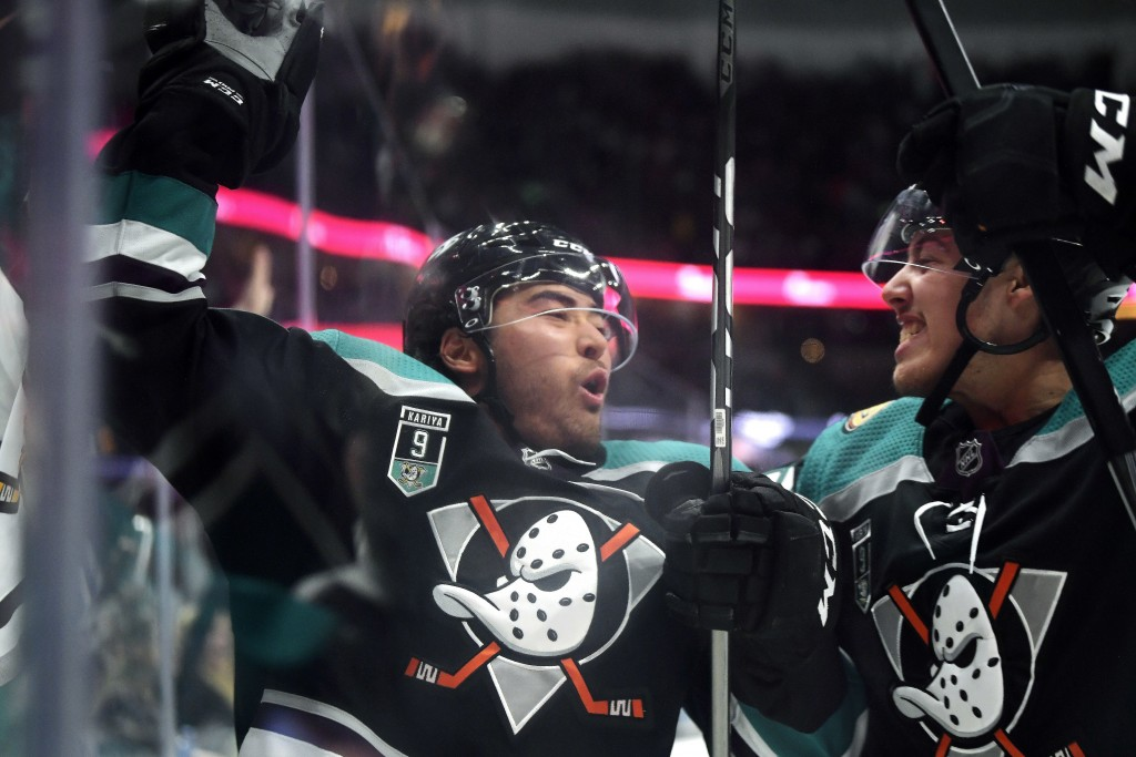 Anaheim Ducks right wing Kiefer Sherwood, left, celebrates his goal with left wing Max Comtois during the second period of an NHL hockey game against