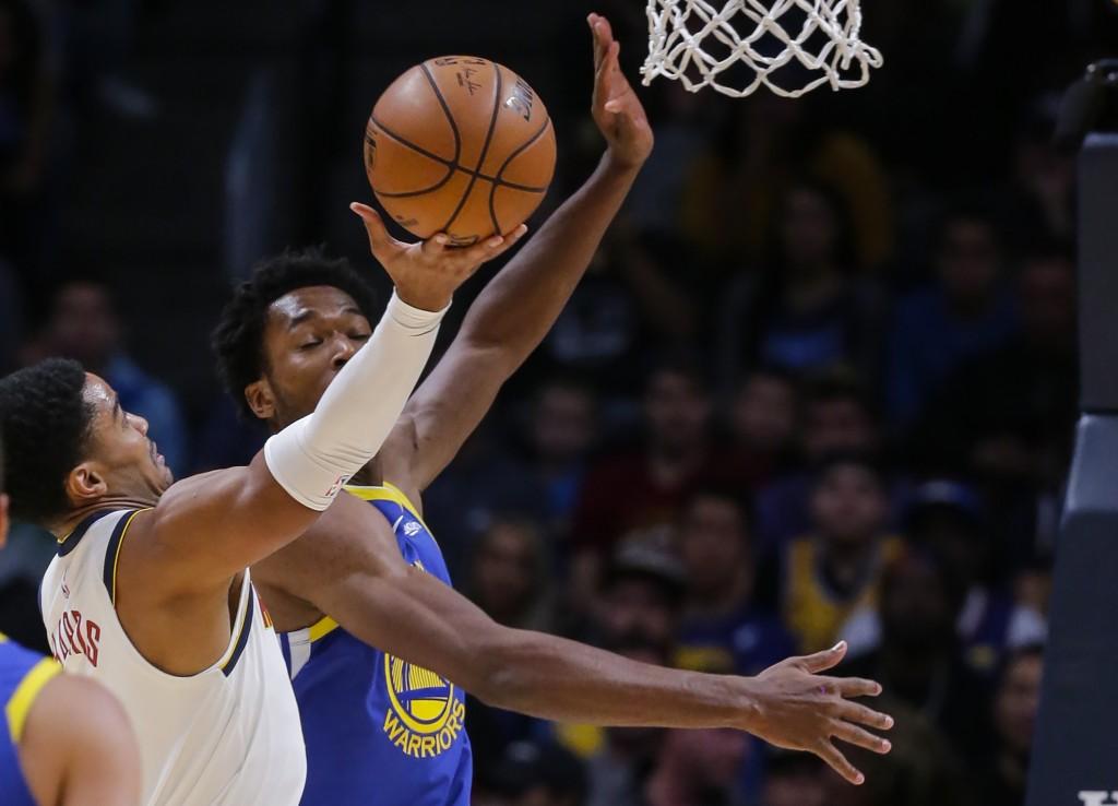 Denver Nuggets guard Gary Harris shoots against Golden State Warriors center Damian Jones (15) during the first quarter of an NBA basketball game, Sun...