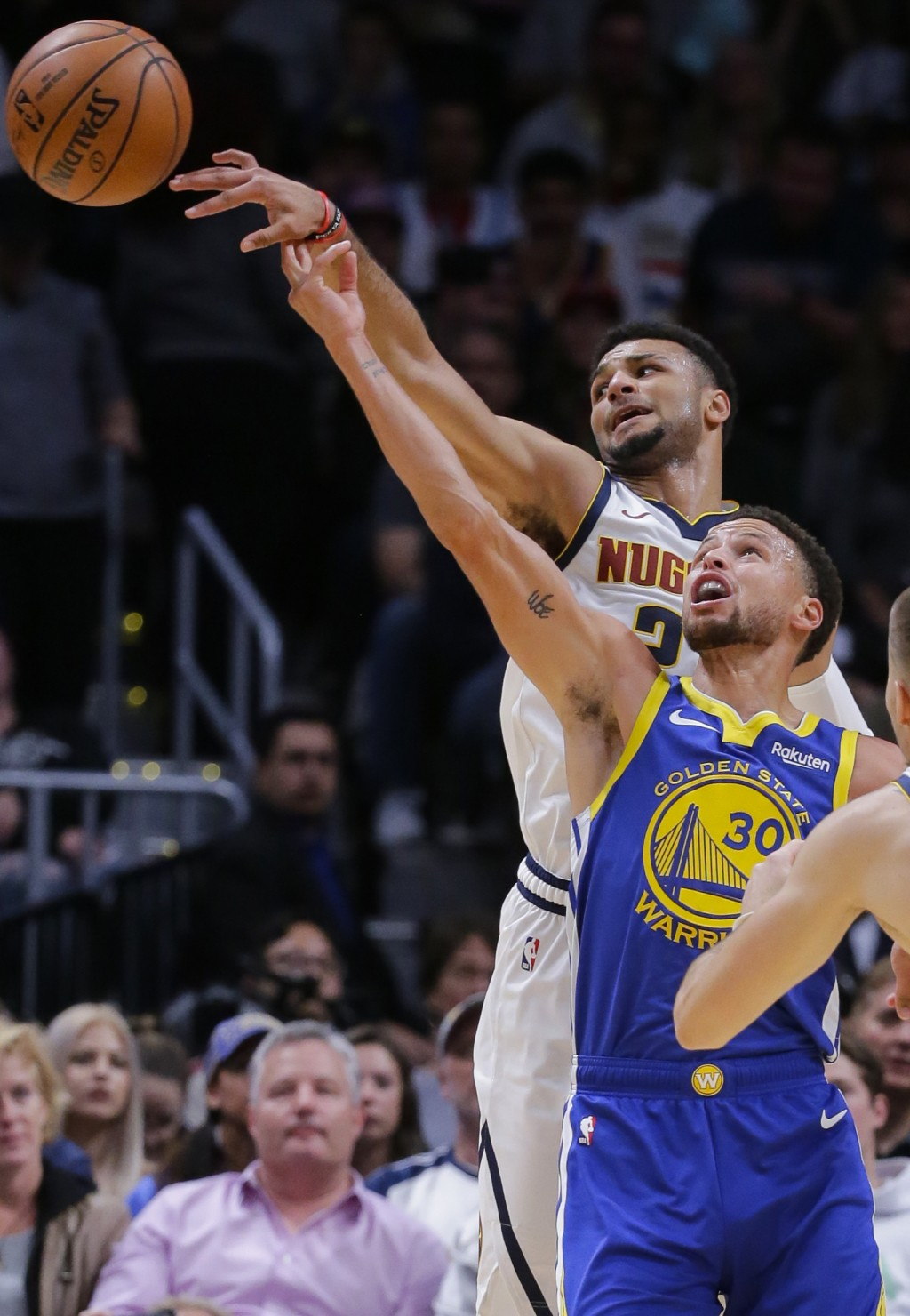 Denver Nuggets guard Jamal Murray (27) passes the ball away from Golden State Warriors guard Stephen Curry (30) during the first quarter of an NBA bas...