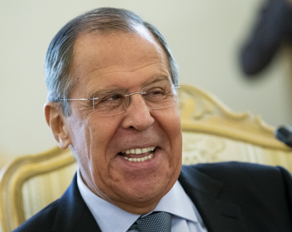 Russian Foreign Minister Sergey Lavrov smiles as he speaks to Madagascar's Foreign Minister Eloi Maxime Alphonse Dovo during their meeting in Moscow, ...