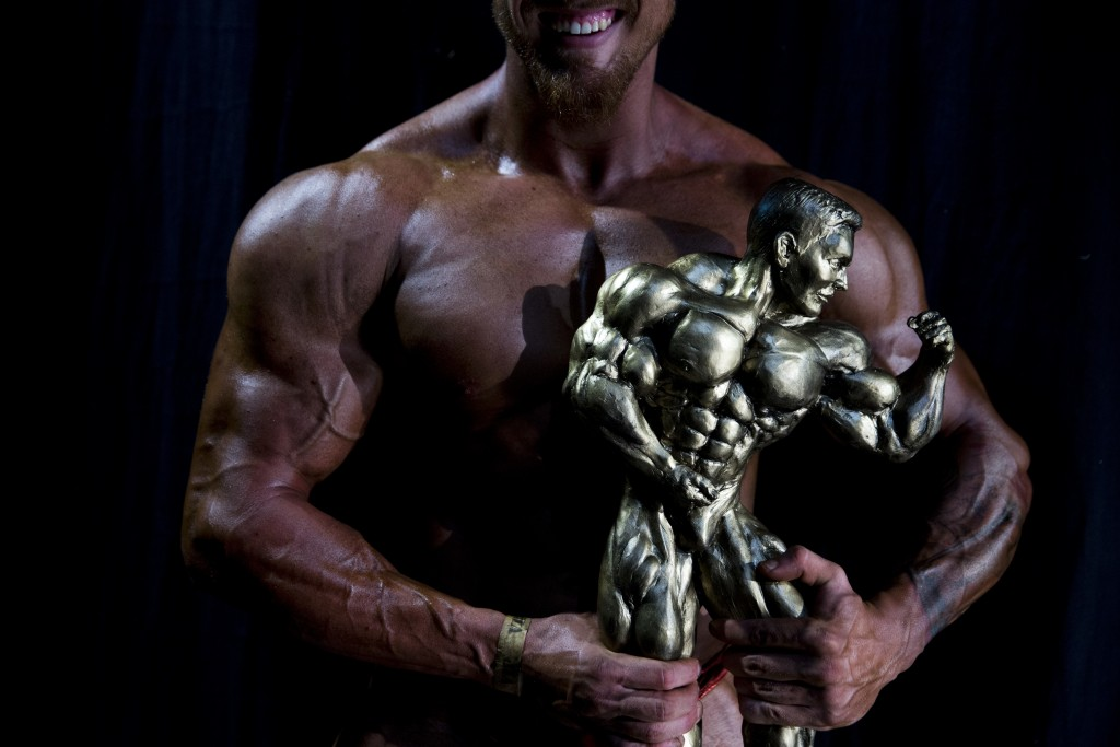 In this Thursday, Oct. 18, 2018 photo, Or Magdasi of Tel Aviv, holds his trophy after winning the National Amateur Body Builders' Association competit...