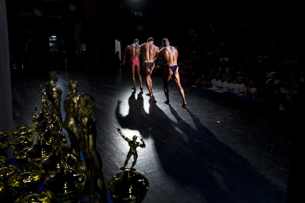 In this Thursday, Oct. 18, 2018 photo, contestants participate in the National Amateur Body Builders' Association competition in Tel Aviv, Israel. In ...
