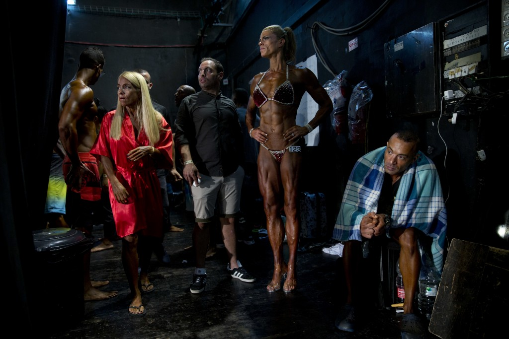In this Thursday, Oct. 18, 2018 photo, contestants wait for their performance backstage during the National Amateur Body Builders' Association competi...