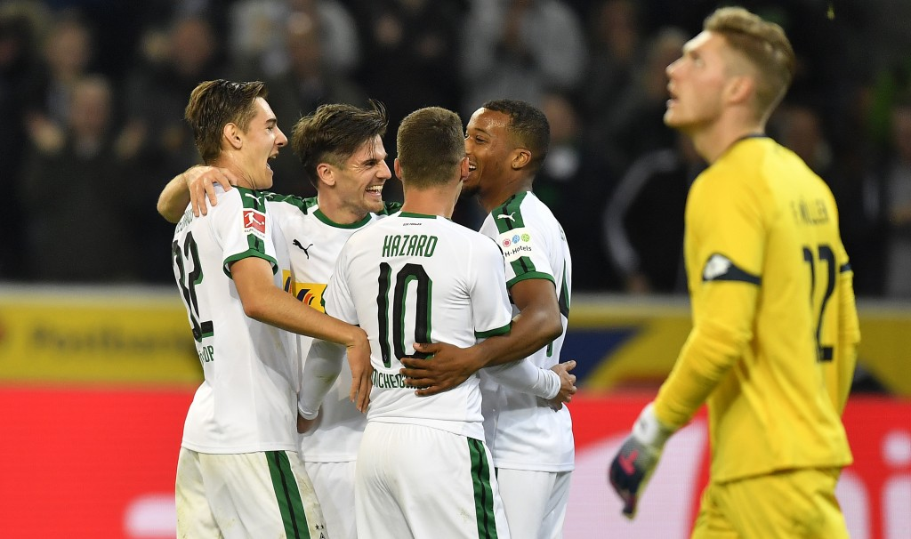 Moenchengladbach's Jonas Hofmann, 2nd from left, celebrates with teammates his third goal during the German Bundesliga soccer match between Borussia M