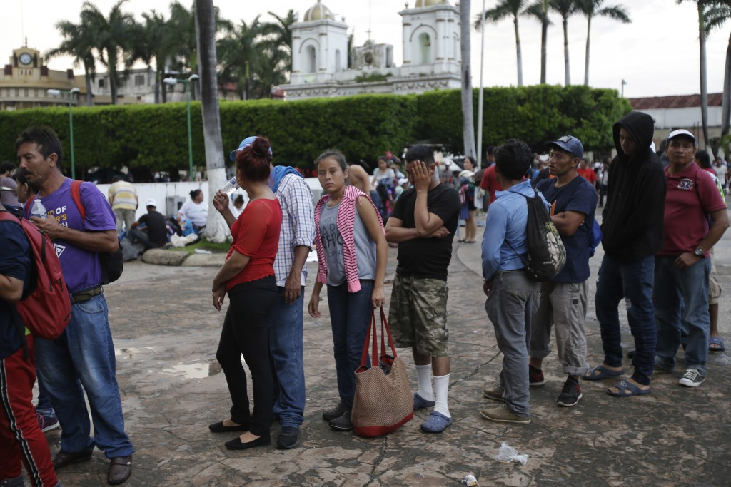 Central American migrants making their way to the U.S. in a large caravan stand in line waiting for medical aid in Tapachula, Mexico, Sunday, Oct. 21,