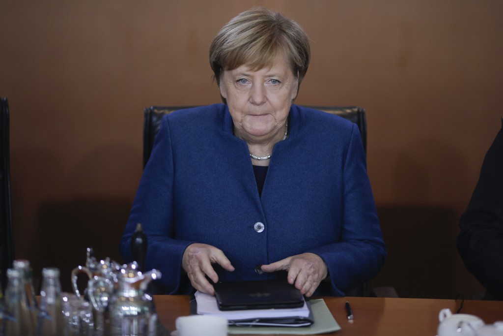 FILE - In this Oct. 17, 2018 file photo German Chancellor Angela Merkel attends the weekly cabinet meeting of the German government at the chancellery...