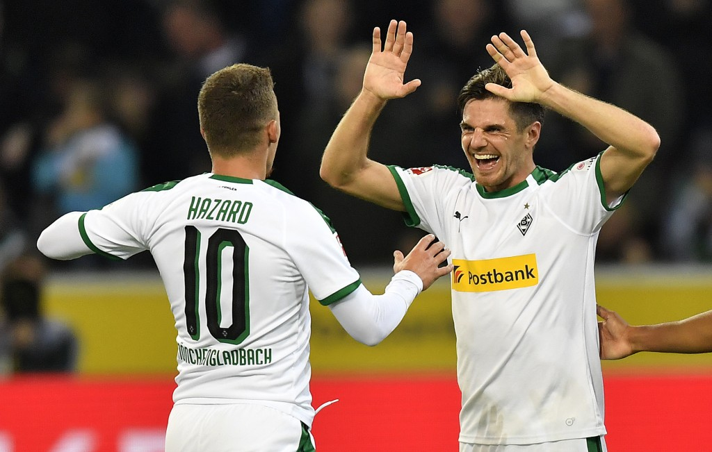 Moenchengladbach's Jonas Hofmann, right, celebrates his third goal with Moenchengladbach's scorer Thorgan Hazard, left, during the German Bundesliga s