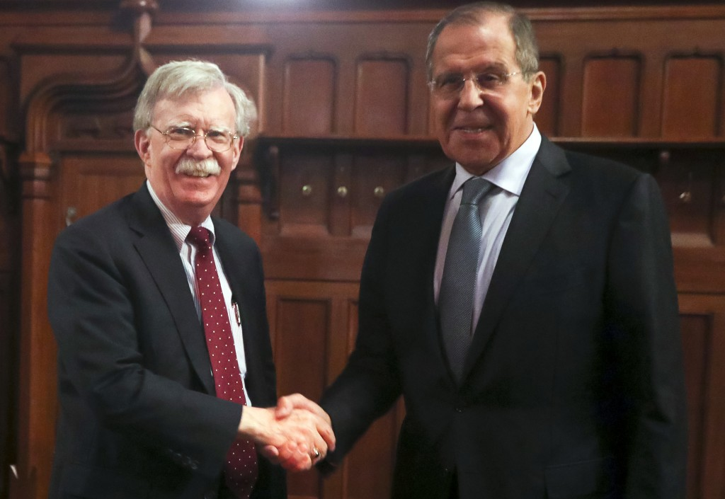 U.S. National Security Adviser John Bolton, left, and Russian Foreign Minister Sergey Lavrov shake hands prior to their talks in Moscow, Russia, Monda...