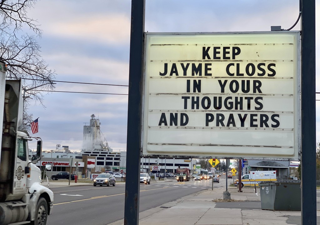 A sign is seen in the small town of Barron, Wis., Tuesday, Oct. 23, 2018, where 13-year-old Jayme Closs was discovered missing Oct. 15 after her paren...