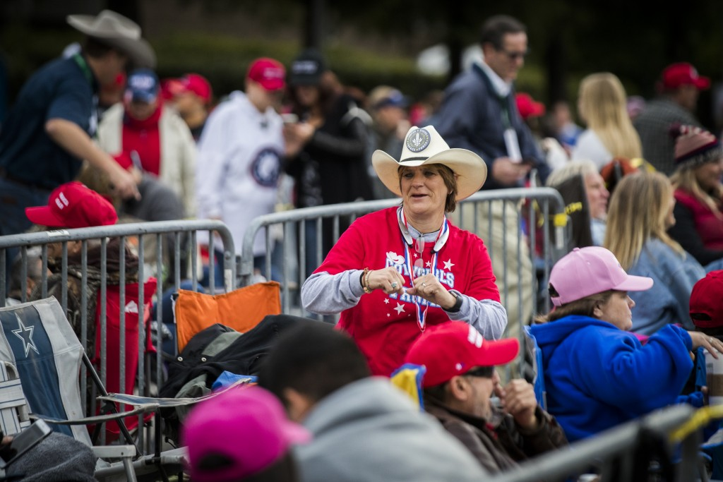 People arrive before a scheduled President Donald Trump rally for Sen. Ted Cruz at the Toyota Center on Monday, Oct. 22, 2018, in Houston. (Marie D. D
