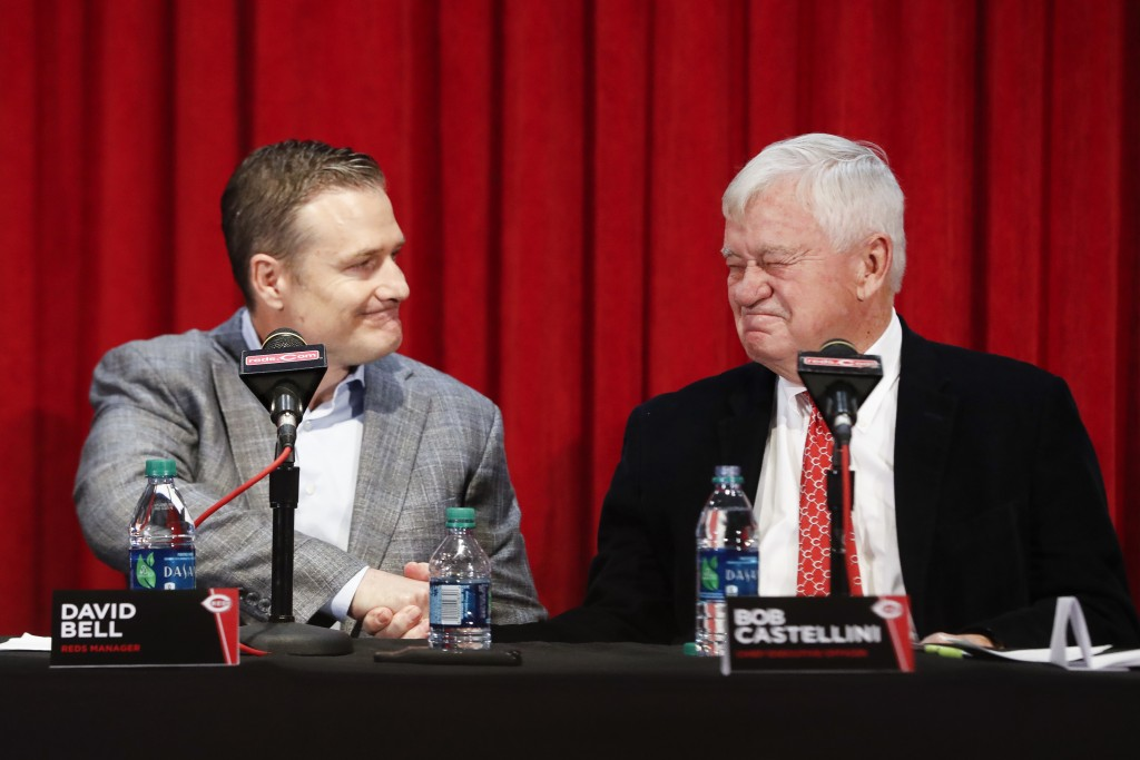 Cincinnati Reds manager David Bell, left, shakes hands with Bob Castellini, CEO, right, during a news conference, Monday, Oct. 22, 2018, in Cincinnati