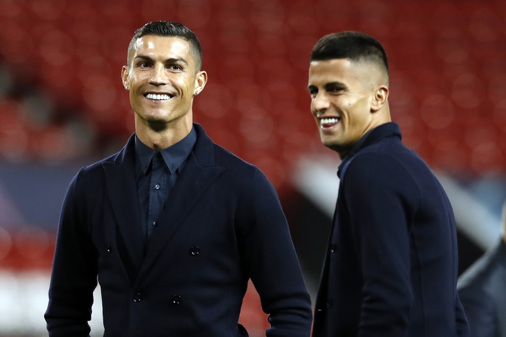 Juventus' Cristiano Ronaldo, left, during the walkaround at Old Trafford, Manchester, England, Monday, Oct. 22, 2018. Juventus will play a Champions L