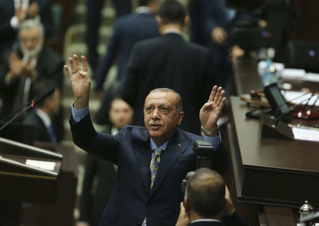 Turkey's President Recep Tayyip Erdogan waves as he arrives to address members of his ruling Justice and Development Party (AKP), in Ankara, Turkey, T...
