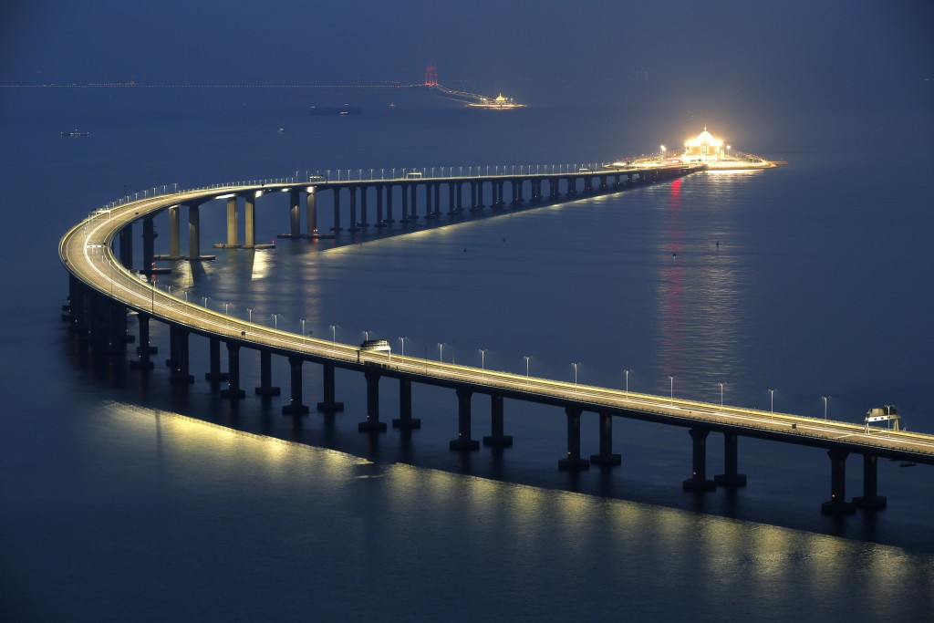 The Hong Kong-Zhuhai-Macau Bridge is lit up in Hong Kong, Monday, Oct. 22, 2018. The bridge, the world's longest cross-sea project, which has a total ...