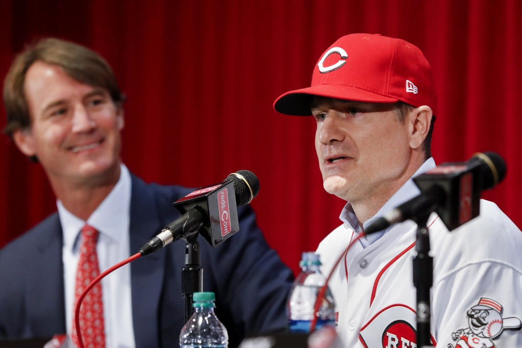 Cincinnati Reds manager David Bell, right, speaks alongside Dick Williams, president of baseball operations, left, during a news conference, Monday, O