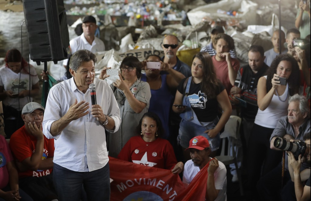 Workers' Party presidential candidate Fernando Haddad speaks to workers at a recycling cooperative, in Sao Paulo, Brazil, Monday, Oct. 22, 2018. Hadda
