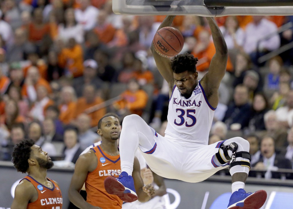 FILE - In this March 23, 2018, file photo, Kansas' Udoka Azubuike (35) dunks as Clemson's Gabe DeVoe, left, and Aamir Simms watch during the second ha...