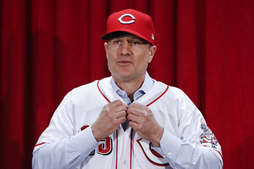 Cincinnati Reds manager David Bell puts on his number 25 jersey during a news conference, Monday, Oct. 22, 2018, in Cincinnati. Bell has been hired as...