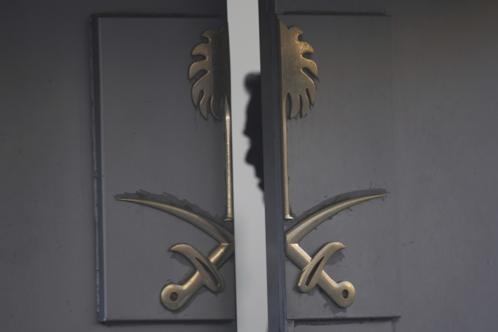 FILE - In this Oct. 16, 2018, file photo, a security personnel is seen inside the entrance of the Saudi Arabia's Consulate in Istanbul. One mystery su...