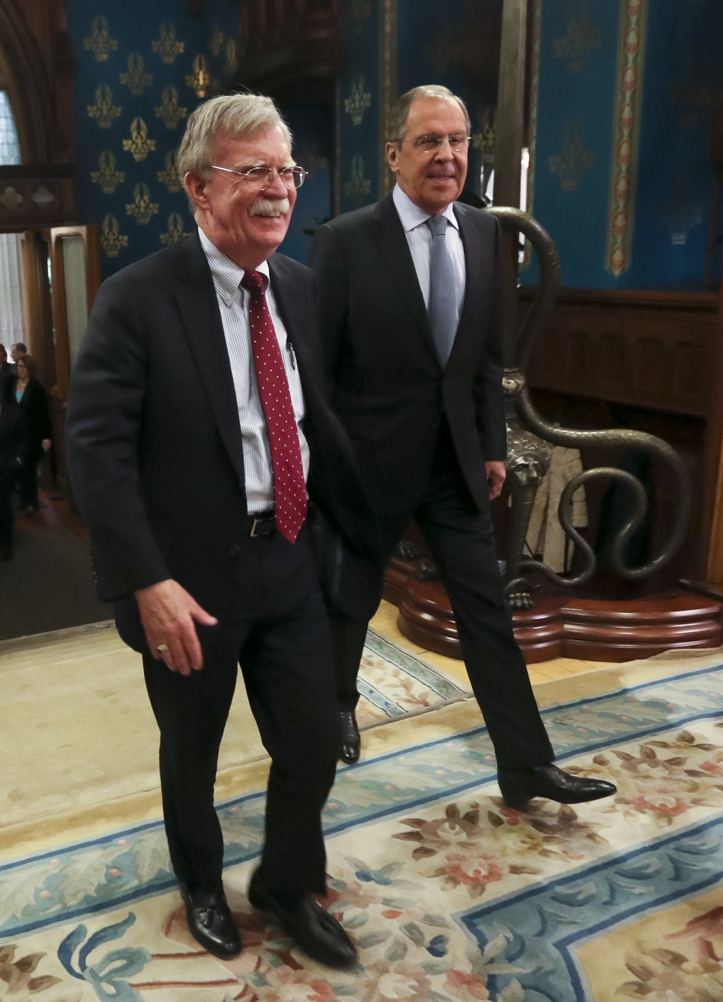 U.S. National Security Adviser John Bolton, left, and Russian Foreign Minister Sergey Lavrov enter a hall for their talks in Moscow, Russia, Monday, O...