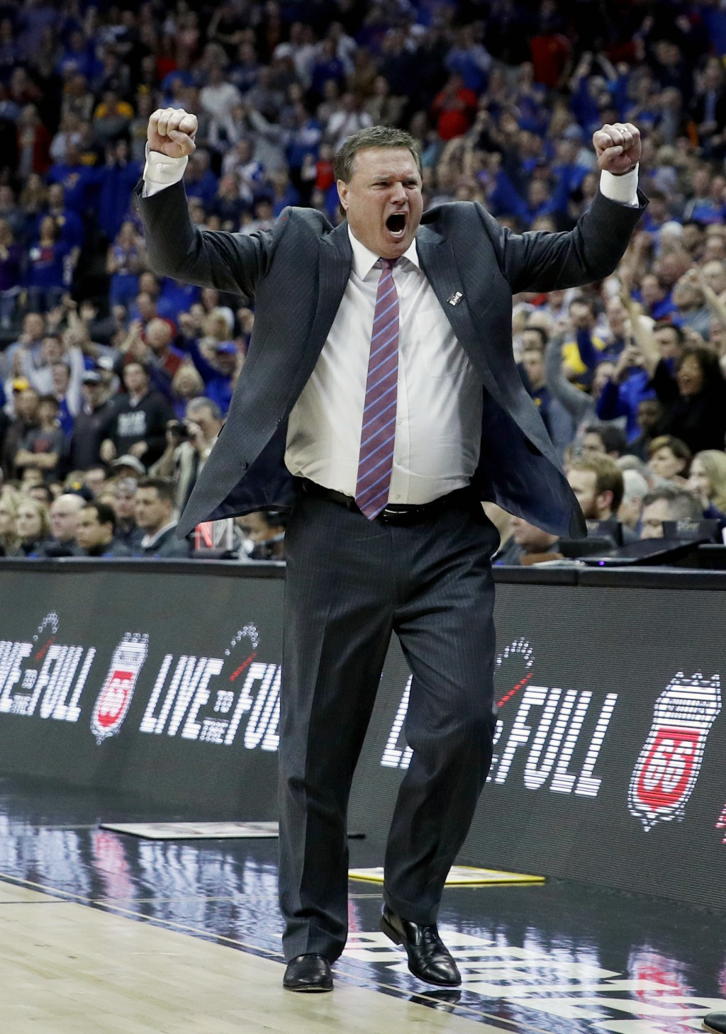 FILE - In this March 10, 2018, file photo, Kansas head coach Bill Self celebrates after winning the NCAA college basketball championship game against ...