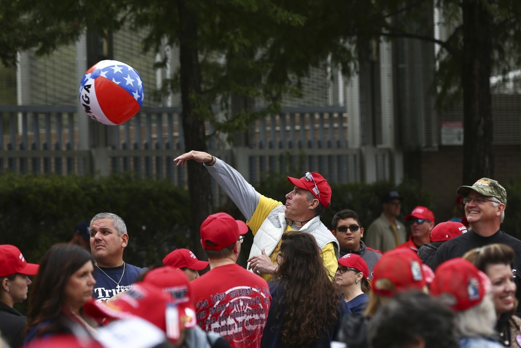 People arrive before a scheduled President Donald Trump rally for Sen. Ted Cruz at the Toyota Center on Monday, Oct. 22, 2018, in Houston. (Godofredo