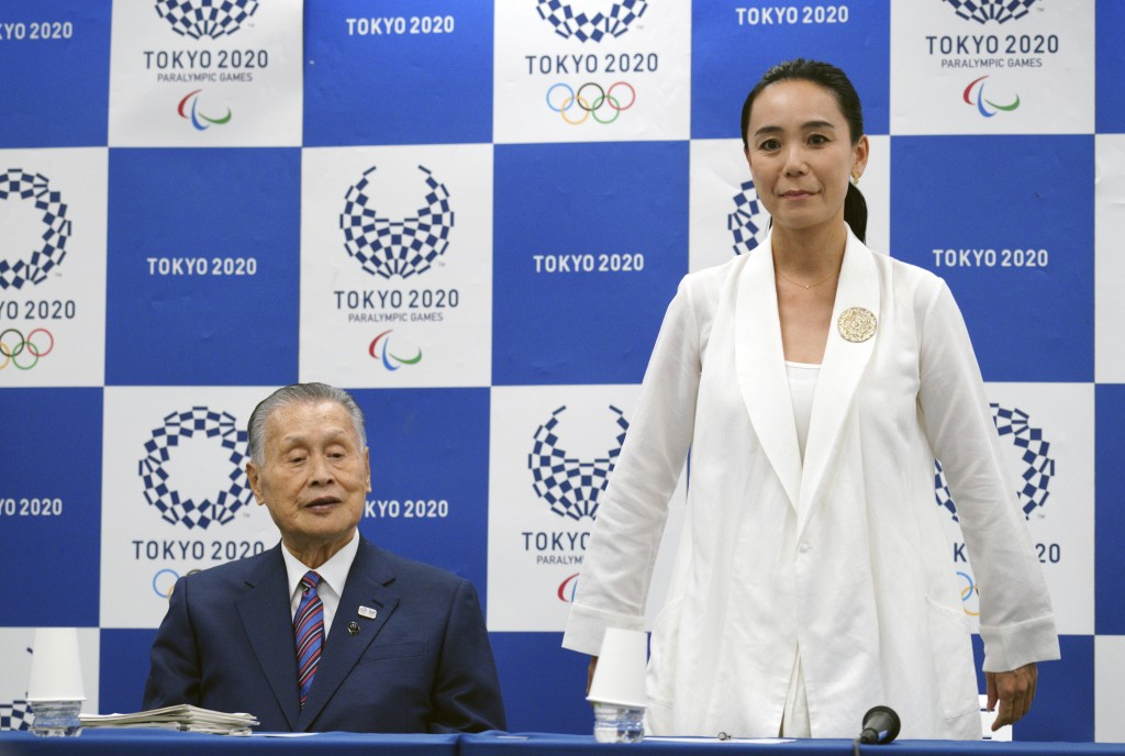 Japanese film director Naomi Kawase, right, is introduced to the media next to Tokyo Olympic organizing committee President Yoshiro Mori during a pres...