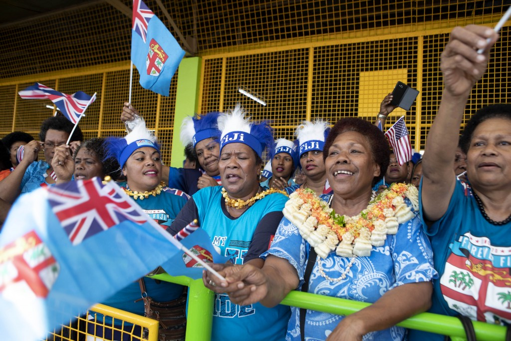 Local Fijian women wait for the arrival of Meghan, Duchess of Sussex at a market in Suva, Fiji, Wednesday, Oct. 24, 2018. Prince Harry and his wife Me
