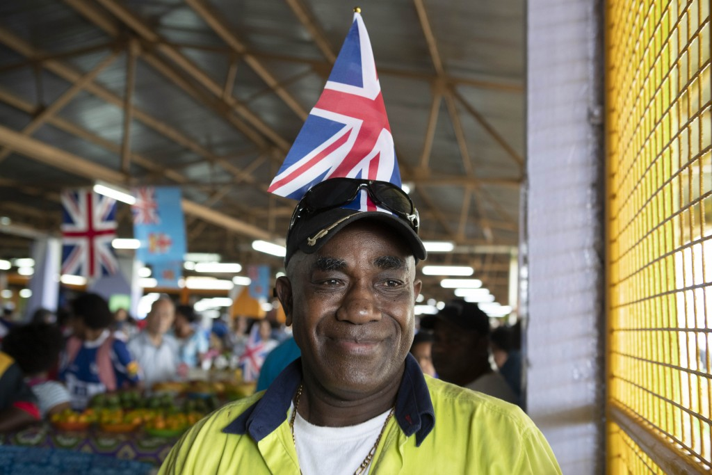 A local Fijian man waits for the arrival of Meghan, Duchess of Sussex at a market in Suva, Fiji, Wednesday, Oct. 24, 2018. Prince Harry and his wife M...