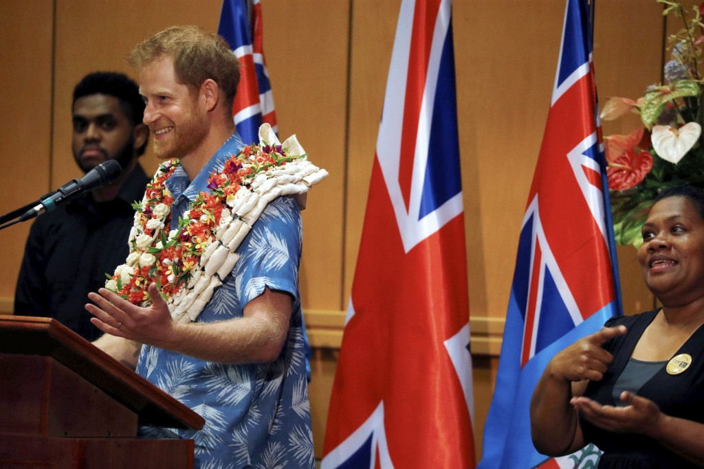 Britain's Prince Harry delivers a speech at the University of the South Pacific in Suva, Fiji, Wednesday, Oct. 24, 2018. Prince Harry and his wife Meg...