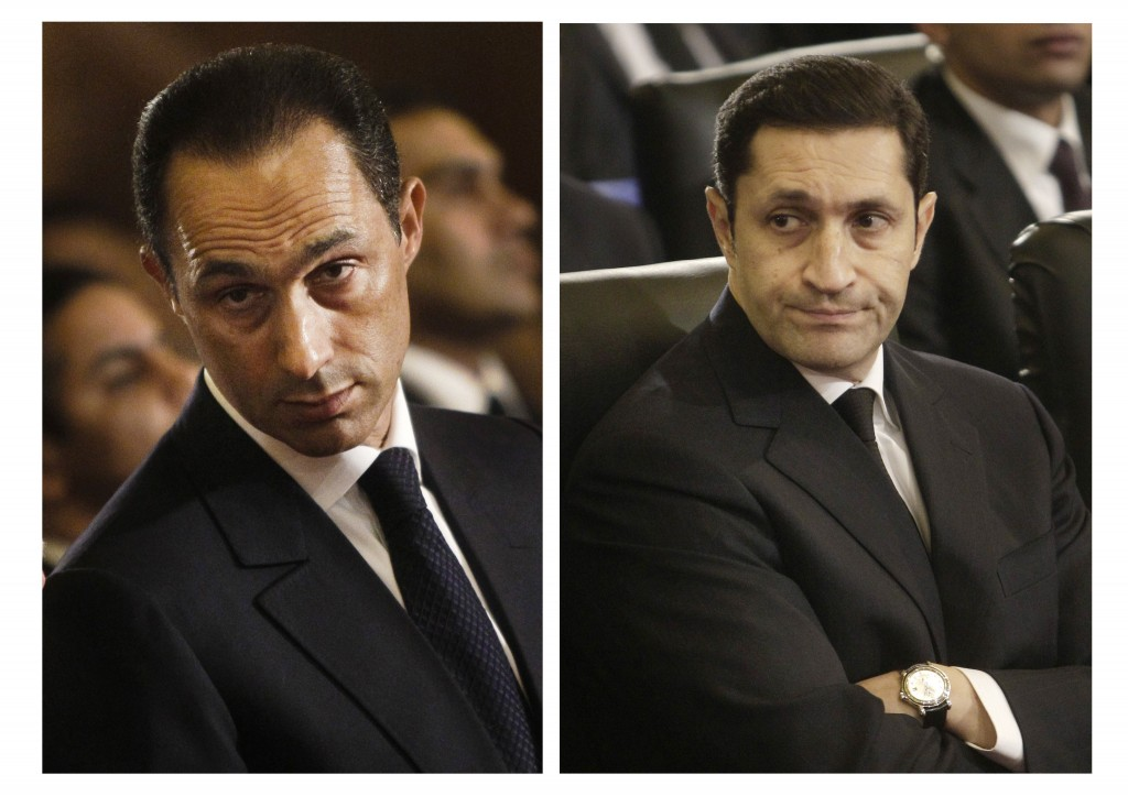 FILE - This combination of Jan. 6, 2011 file images shows sons of then Egyptian President, Gamal Mubarak, left, and Alaa Mubarak, attending a Christma