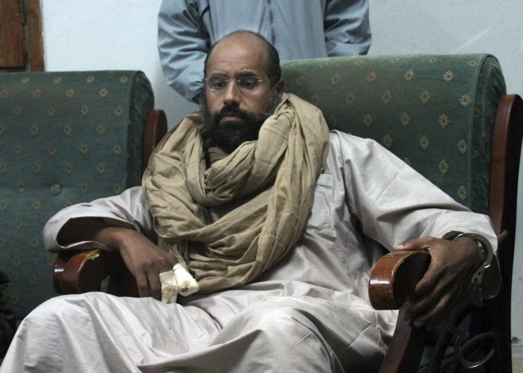 FILE - In this Nov. 19, 2011, file photo, Moammar Gadhafi's son, Seif al-Islam, is held in the custody of revolutionary fighters in Zintan, Libya. One