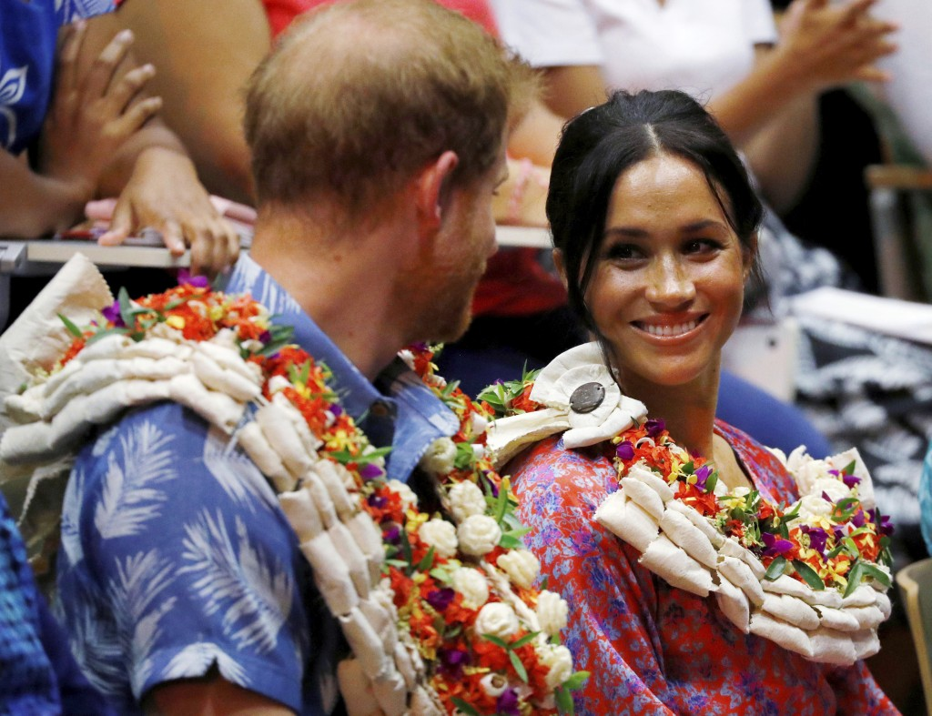 Britain's Prince Harry and Meghan, Duchess of Sussex, at the University of the South Pacific in Suva, Fiji, Wednesday, Oct. 24, 2018. Prince Harry and