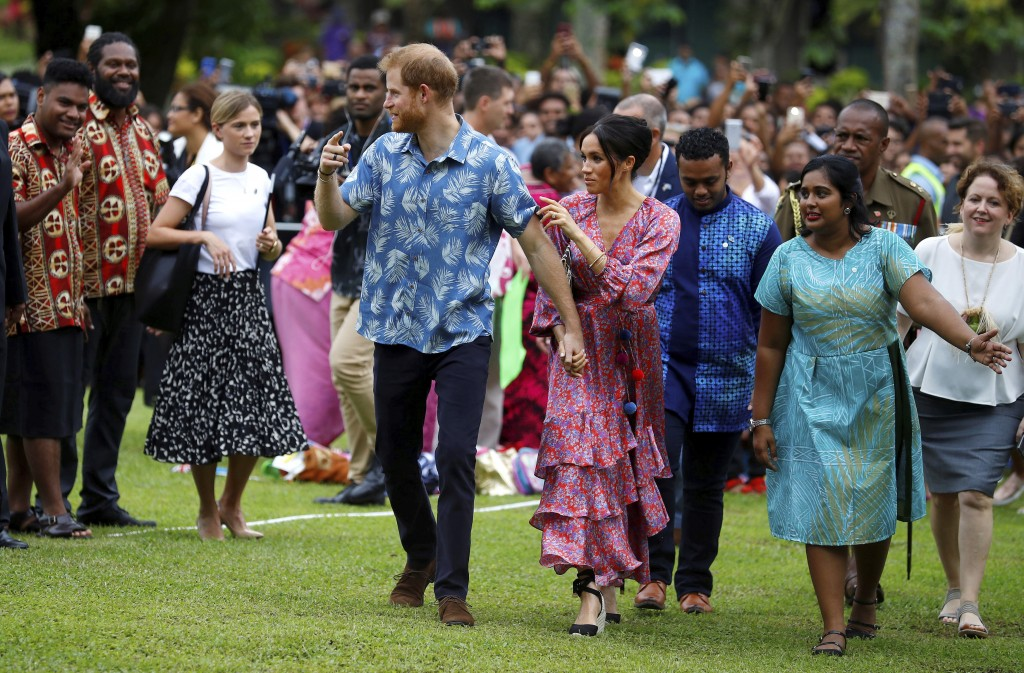 Britain's Prince Harry and Meghan, Duchess of Sussex visit the University of the South Pacific in Suva, Fiji, Wednesday, Oct. 24, 2018. Prince Harry a...