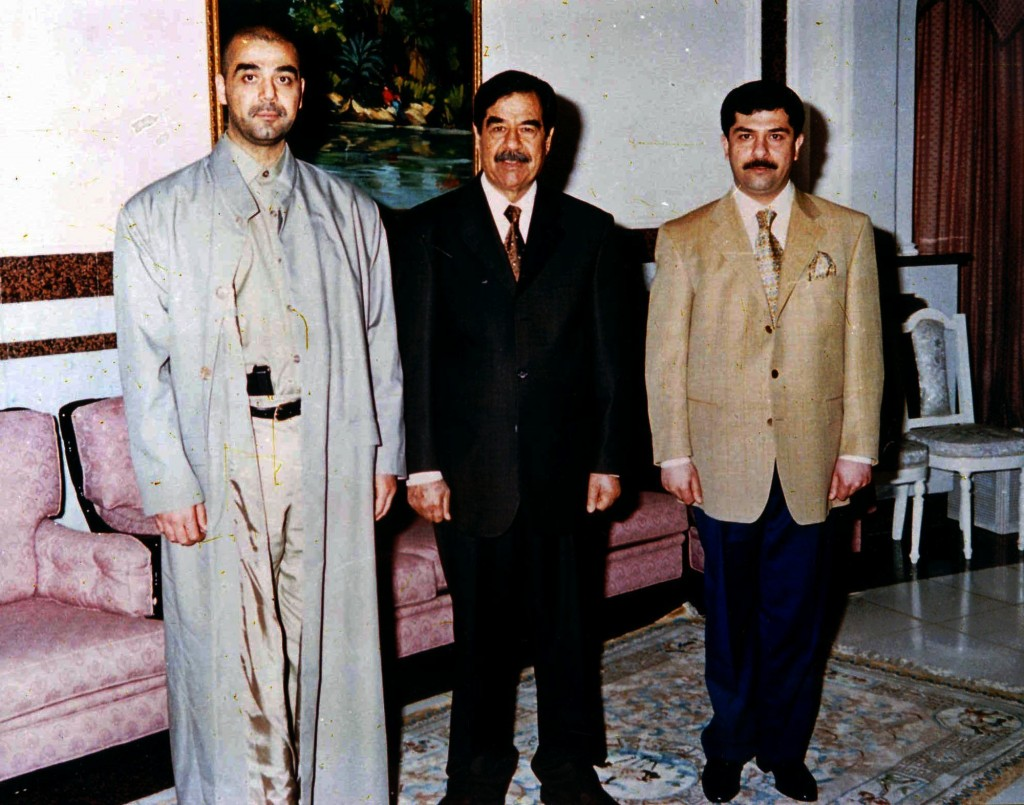 FILE - In this undated file photo, Iraqi ruler Saddam Hussein poses with his two sons Oday, left, and Qusay. Uday was feared and reviled for his viole