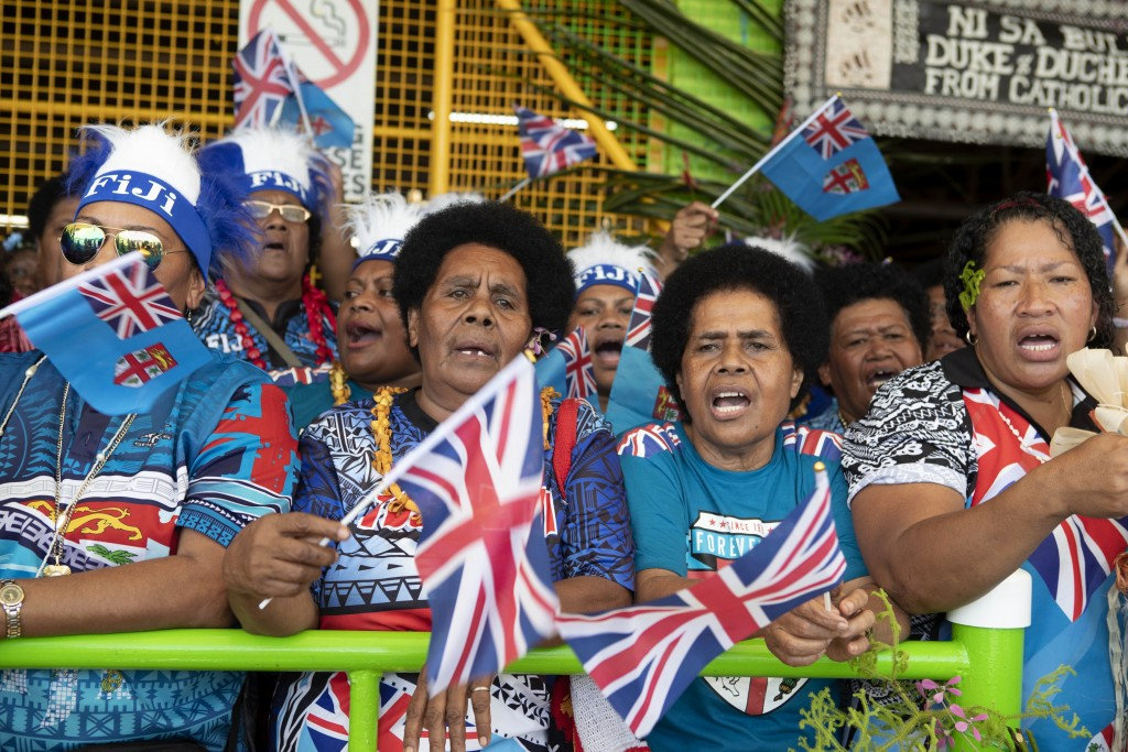 Local Fijian women wait for the arrival of Meghan, Duchess of Sussex at a market in Suva, Fiji, Wednesday, Oct. 24, 2018. Prince Harry and his wife Me...