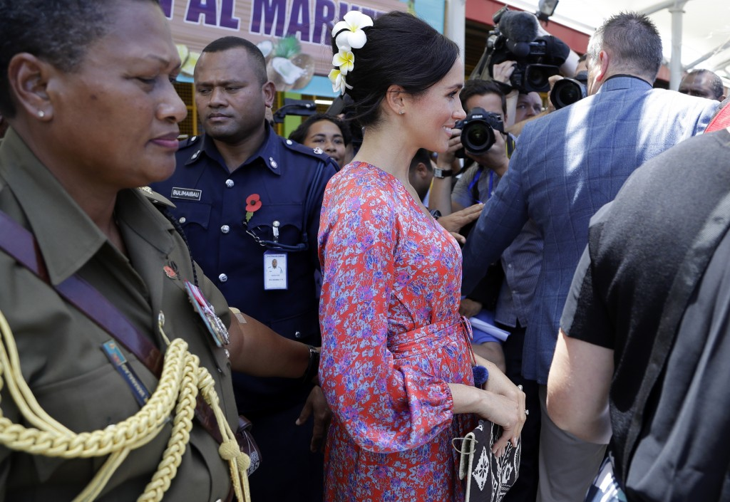 Meghan, Duchess of Sussex during a visit to a market in Suva, Fiji, Wednesday, Oct. 24, 2018. Britain's Prince Harry and his wife Meghan are on day ni...