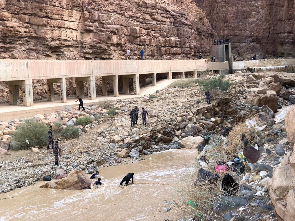 Jordanian rescuers search for survivors of flash floods at the Dead Sea area, Jordan, Friday, Oct. 26, 2018. The body of a 12-year-old girl, was recov...