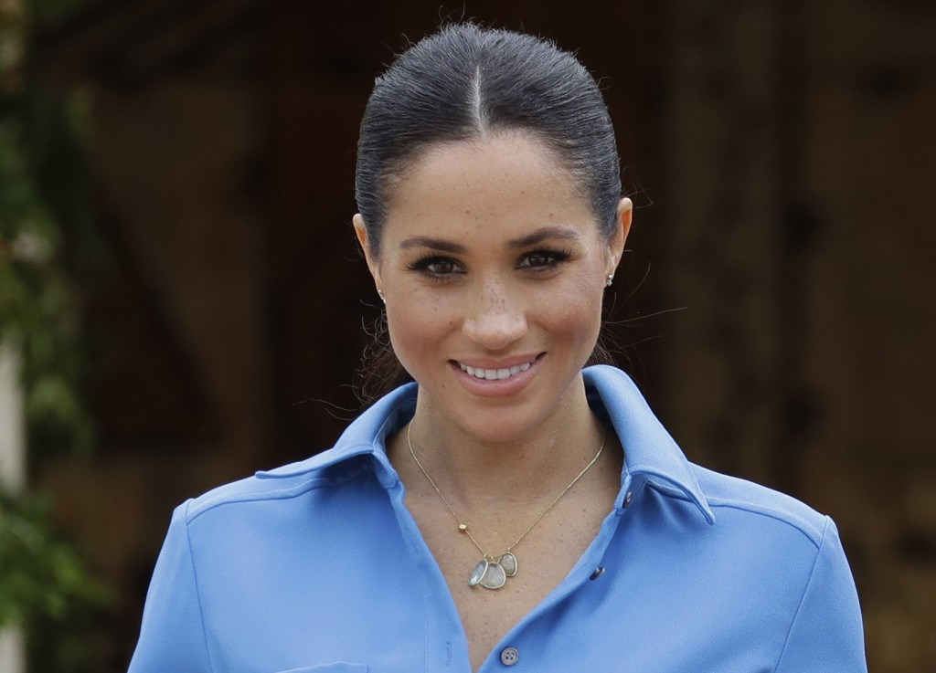 Britain's Meghan, Duchess of Sussex smiles during a visit to Tupou College in Tonga, Friday, Oct. 26, 2018. Prince Harry and his wife Meghan are on da
