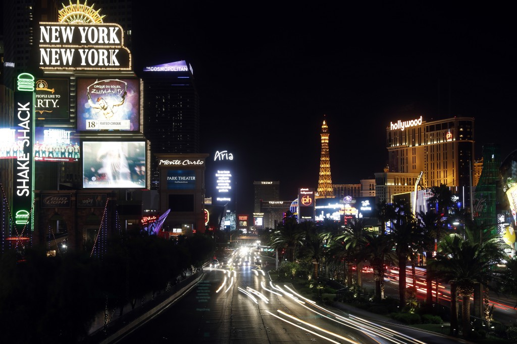 FILE - This Sunday, Oct. 8, 2017, file photo shows the Las Vegas Strip in Las Vegas. A marijuana trade group says pot production, processing and sales...