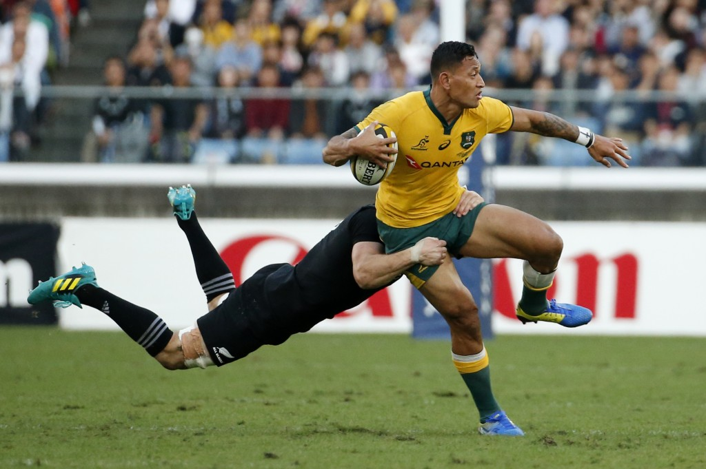 Australia's Israel Folau looks for support as he is tackled by New Zealand's Matt Todd during their Bledisloe Cup rugby test at the Nissan Stadium in