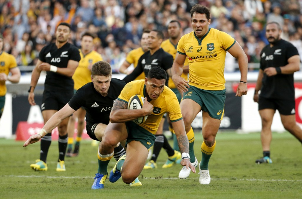 Australia's Israel Folau scores a try for the Wallabies during their Bledisloe Cup rugby test against the All Blacks at the Nissan Stadium in Yokohama