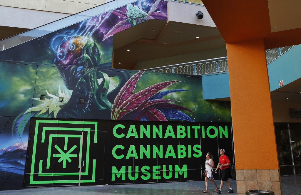 FILE - In this Tuesday, Sept. 18, 2018, file photo, people walk by the Cannabition cannabis museum in Las Vegas. The museum celebrating all things can...