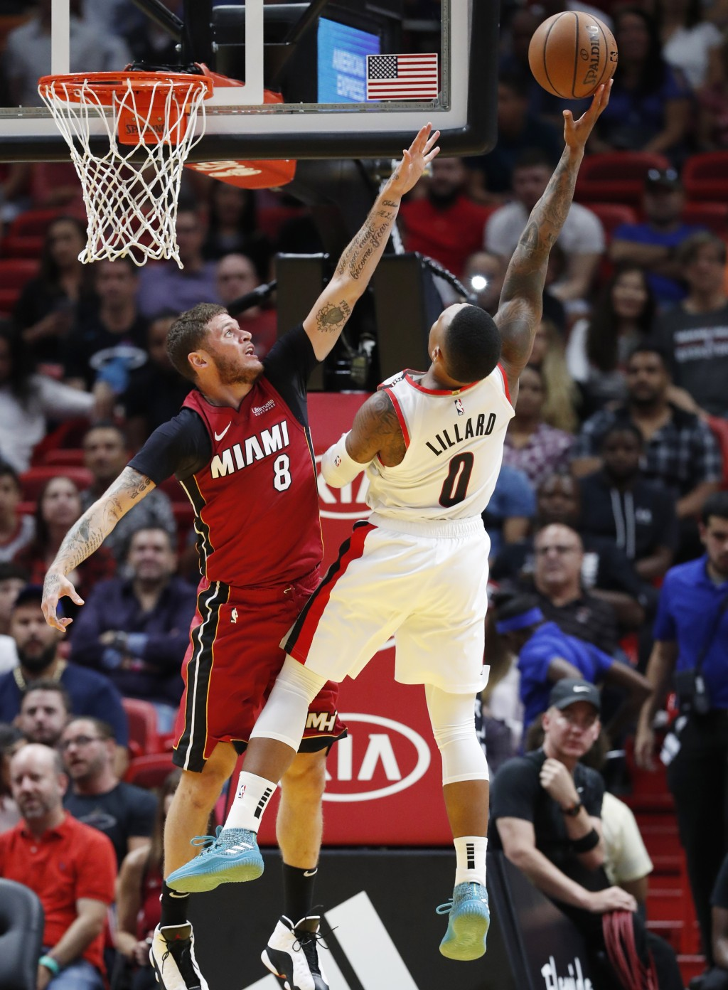 Portland Trail Blazers guard Damian Lillard (0) goes up to shoot against Miami Heat guard Tyler Johnson (8) during the first half of an NBA basketball...