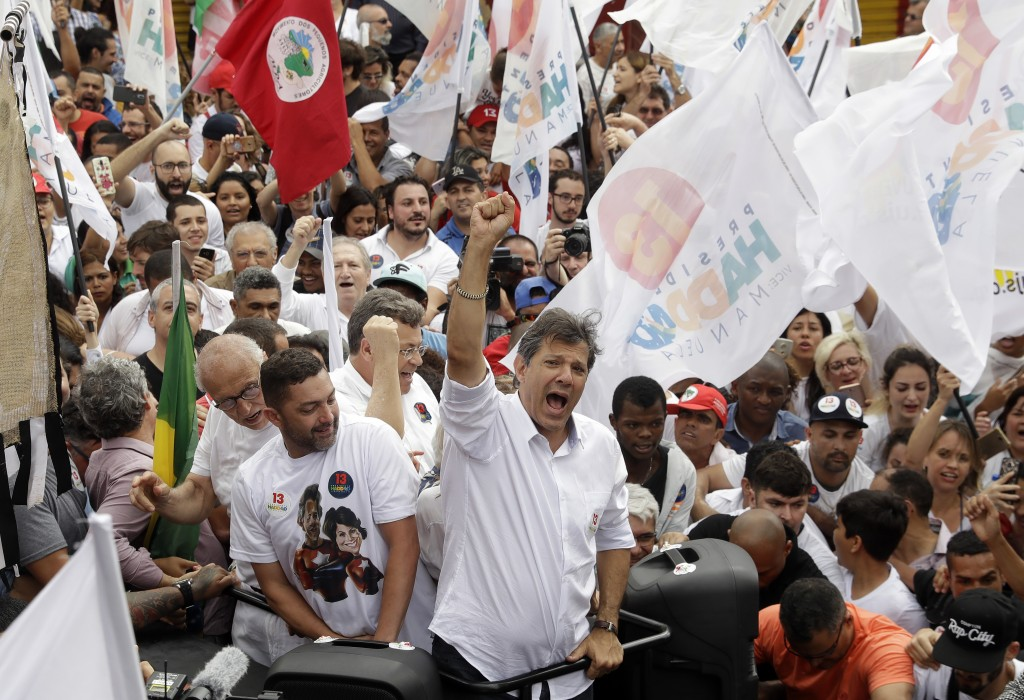 Fernando Haddad, Brazil's presidential candidate for the Workers' Party, joins a campaign rally at the Heliopolis slum of Sao Paulo, Brazil, Saturday,...