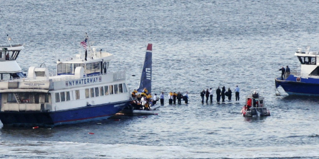 FILE - In this Jan. 15, 2009, file photo, ferry boats surround a US Airways aircraft that went down in the Hudson River in New York as passengers stan...