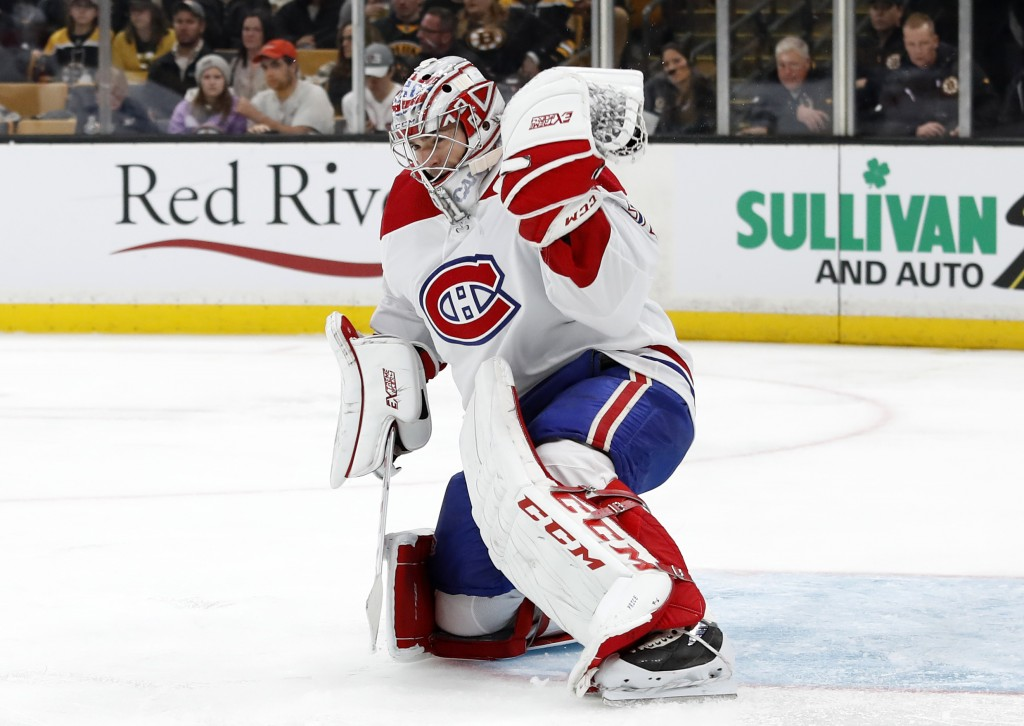 Montreal Canadiens goaltender Carey Price makes a glove-save against the Boston Bruins during the second period of an NHL hockey game Saturday, Oct. 2...